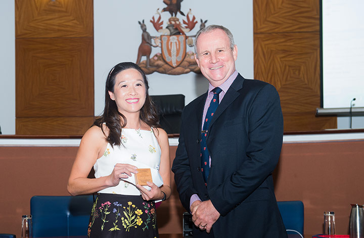 NT Attorney General, The Honourable John Elferink MLA presents the Attorney General Medal to law student Adeline Tran.