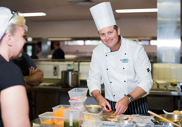 Commercial cookery lecturer Matthew Cook prepares an ocean-to-plate meal at NT Food Week