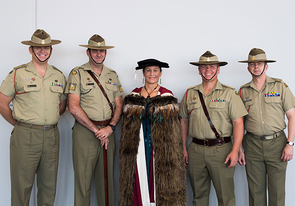 PhD graduate Capt Debbie Hohaia wearing traditional Maori korowai cloak. With Lt. Col Mark Buldock (left), Warrant Officer Class One Craig Webb, Captain Quentin Dalziell and Major Paul Chambers
