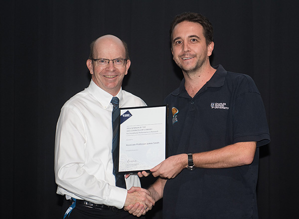 Associate Professor James Smith receives the award for Exceptional Performance in Research