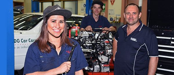 (From left): Chanel Lambert and colleague Curtis Smith take some tips from Automotive Technology lecturer Bruce Kimm