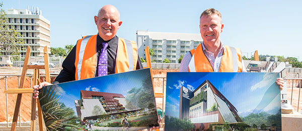 CDU Vice-Chancellor Prof Scott Bowman and Minister for Jobs and Training Paul Kirby unveil the designs of the Education and Community Precinct.