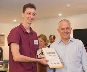 Third Year Software Engineering student Robert Jackson receives his award from Prime Minister Malcolm Turnbull as part of the CDU IT Code Fair