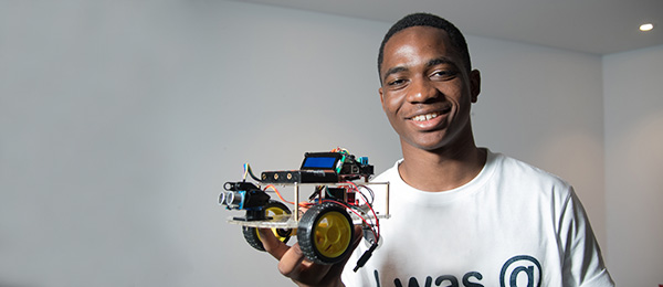 First Year Software Engineering student Joel Benesha with his Obstacle Avoidance Arduino robot