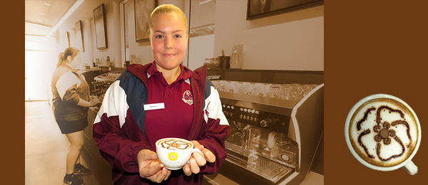 Monique George presents a cup of coffee topped with the Desert Lantern logo in chocolate