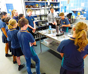 Middle school students learn to make a café-standard coffee