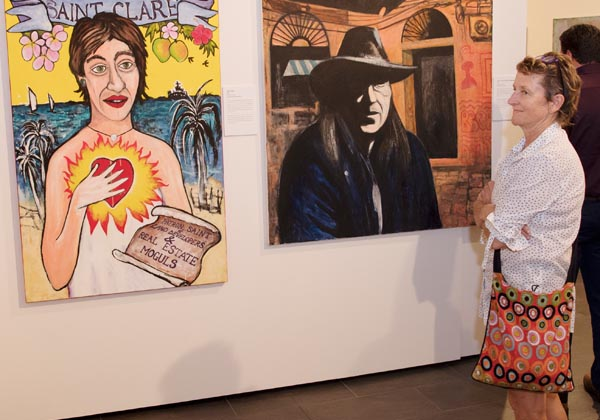 Margin Cotter views artworks depicting former chief minister Clare Martin and NT identity Chips Mackinolty