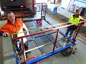 Engineering students James Price and Mick Sheehan check measurements on the safety rail