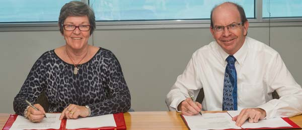 Vice-Chancellor Professor Simon Maddocks and Ms Marion Guppy sign the MOU