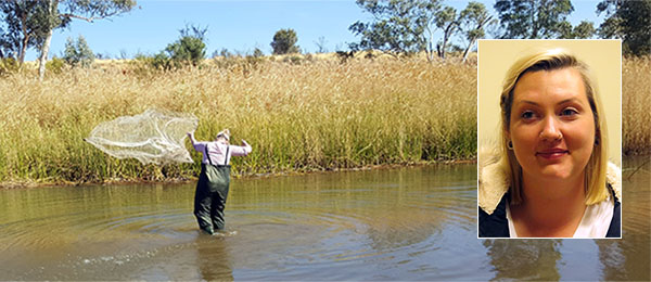Ecology student Emily Moyes throws a cast net during an aquatic survey