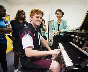 Taminmin College student Sam Mauner tests out CDU's new Yamaha Disklavier Grand Piano at Year 10 Discovery Day
