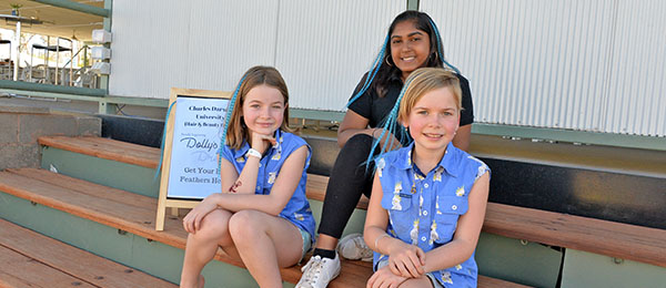 Retail Cosmetics student Avani Kumar with two Dolly's Day clients. Image: Nikki Westover