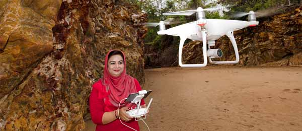Education Lecturer Dr Farha Sattar tests a UAV at Darwin's Dripstone Cliffs. CDU researchers are making a bid for a centre of knowledge in the use of drones in science