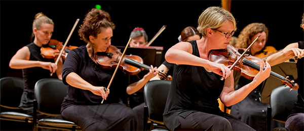DSO's violin section with Concertmaster Katie Betts at lead violin