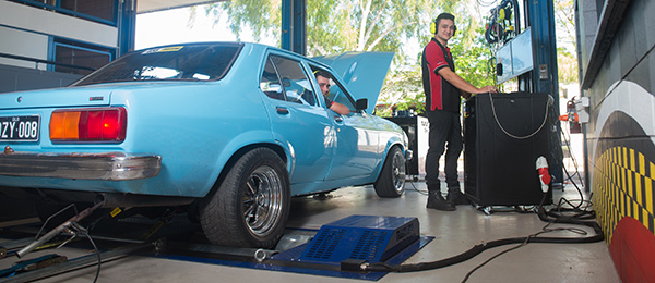 Light vehicle automotive students with the new dynamometer at Casuarina campus, from left: Tyrone Anderson and Kevin Bucher