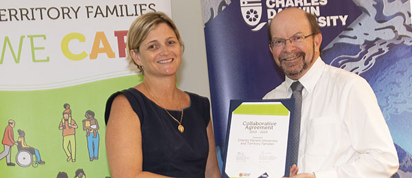NT Department of Families Deputy Chief Executive of Organisational Services Nicole Hurwood and CDU Vice-Chancellor Professor Simon Maddocks after the signing of the 2019-2024 Collaborative Agreement. Photo courtesy of Territory Families