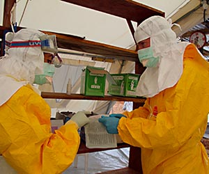 Taking up the fight against Ebola in Sierra Leone. Image: P.K. Lee / MSF