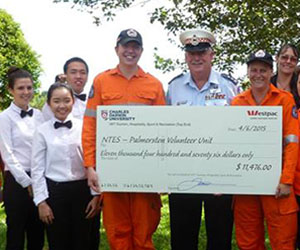 The Palmerston NTES Volunteer Unit receives a cheque for $11,476