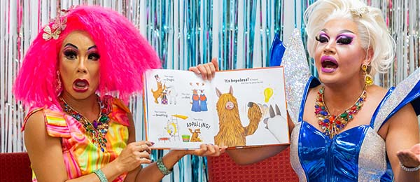 Drag queens Fairy Ferocious and Princess Prawn visited CDU's Alice Springs campus to take part in Drag Queen Story Time as part of the FABalice Festival. Photo: Emma Murray