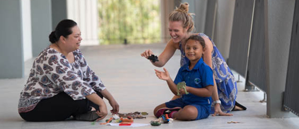 International expert Rochelle Ritzi led the Australia-first play therapy workshop in Darwin. Pictured with workshop participant Johanna Van-Grinsven and six-year-old Marie Rose Naivalu