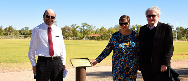 From left: Vice Chancellor Professor Simon Maddocks, Linda Fitzsimons and Deputy Chancellor Richard Ryan AO at the Paul Fitzsimons Oval in Alice Springs