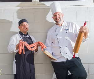 Food lovers have rolled into NT Food Week. From left: Commercial Cookery and Bakery lecturer Antonio Tjung and team leader Robert Schwerdt
