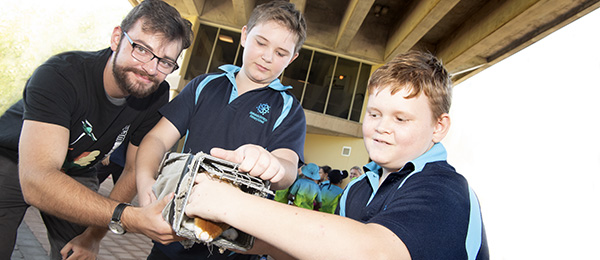 PhD student Gavin Trewella with primary school students Rhys and Cooper Lubke