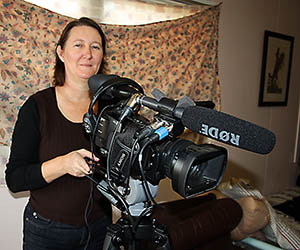 Delyna Baxter prepares to record the story of an Aboriginal pastor worker