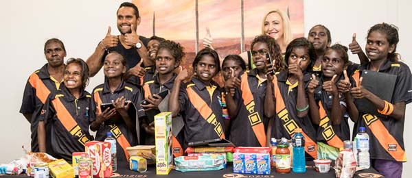 Actor Rob Collins and Northern Territory Administrator Vicki O'Halloran with students from Galiwin'ku