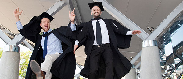 Charles Darwin University 2019 Nursing graduates James Stoddart and Samir Amiri at the last in-person graduation before the COVID-19 pandemic