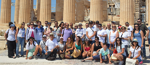 Vice-Chancellor Professor Simon Maddocks (centre) with staff and students at the Parthenon in Greece