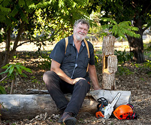Arboriculture lecturer Phil Kenyon demonstrates special chainsaw techniques to create habitat holes from wood