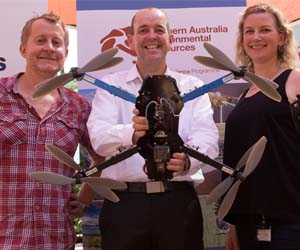 Hub Leader Professor Michael Douglas (centre) holds an octocopter, which was demonstrated at the launch by Tim Whiteside and Krissy Breed from the Supervising Scientist