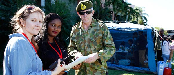 From left – Lucy Frost, Genevine Ifunanya Ebelebe participate in RedR Australia's training simulation exercise