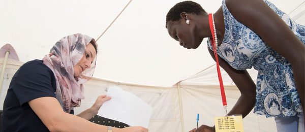 Course coordinator Adriana Stibral (left) barters with student Nyankiir Giir during a simulated disaster training exercise. Photo: Julianne Osborne