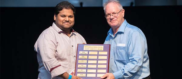 Aman Kathed is presented with the Harry Edmonds Award by the Head of IHD, Dr Philip Mosely