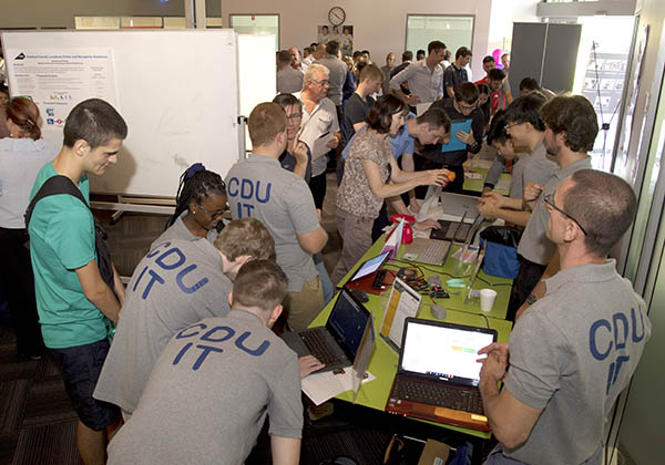 Code fair is a busy day for students as they demonstrate their IT designs to government and industry professionals