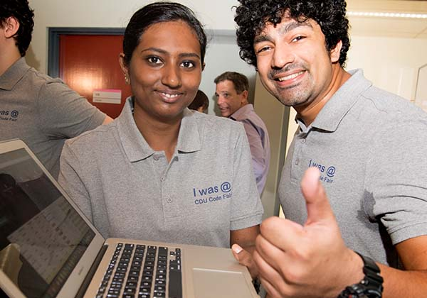 Student Helen Jose congratulates her brother, Alwyn Jose, on winning the coding competition