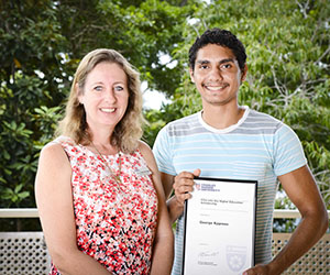 Tiwi Islander George Kypreos is proud to be the first person to receive the Into Uni Higher Education scholarship. Pictured with Acting Pro Vice-Chancellor, Academic Associate Professor Deborah West