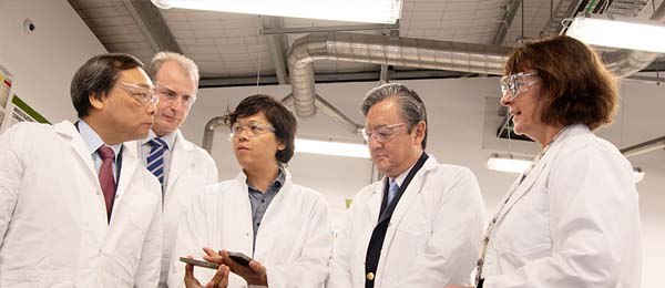 From left - INPEX Corporation CEO Takayuki Ueda, CDU Chancellor Paul Henderson, CDU researcher Dr Khanh Vin Nguyen, INPEX Australia President Director Hitoshi Okawa and acting Vice-Chancellor Professor Sue Carthew during a tour of CDU's North Australian Centre for Oil and Gas