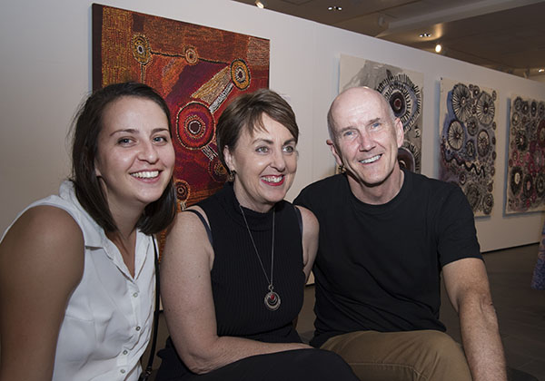 Sophie Anderson, Kaylene Cornick and David Anderson admire the works on show