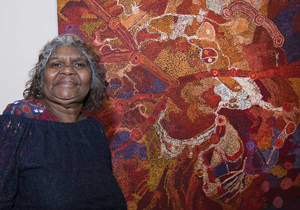 Artist Sylvia Ken with her work, titled - Seven Sisters