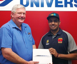 Alice Springs Campus Administrator David Reilly presents Noel Kruger with an iPad