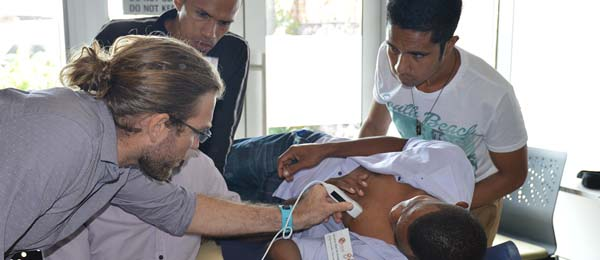 Dr Josh Francis trains Timorese health professionals to test for evidence of RHD by using electrocardiography