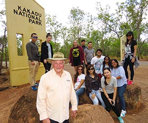 Lance Poulton (wearing hat) and his hospitality students at the entrance to Kakadu