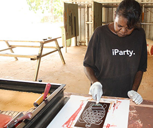 Selina Bundamura is one of seven North Australian artists who learned printmaking and other artistic skills in the Vocational Education and Training course. Photographer: Andrew Barker, Kira Kiro Arts