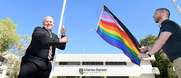 Charles Darwin University Vice-Chancellor Scott Bowman AO raises the rainbow flag to show support for LGBTQIA+ staff and students at CDU's Casuarina campus.