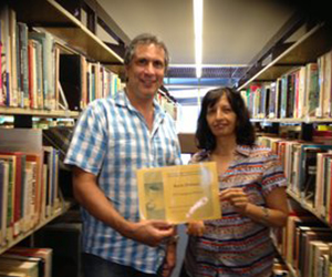 CDU Library Research Services Coordinator Jayshree Mamtora presents Kevin Dolman with his scholarship