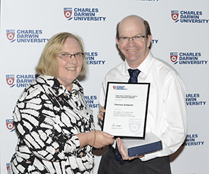 CDU staff member Theresa Caldwell receives a Long Service Recognition award from Vice-Chancellor Professor Simon Maddocks