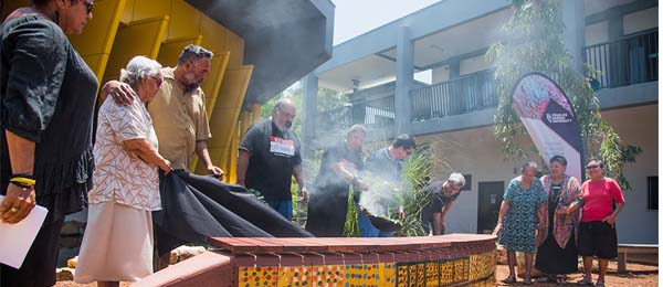 A bench seat featuring the artwork of Midpul (aka Prince of Wales) is unveiled during a ceremony with local Larrakia elders